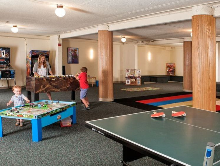 Family fun room with foosball, arcades
