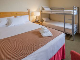 Hotel room with queen bed and bunk bed